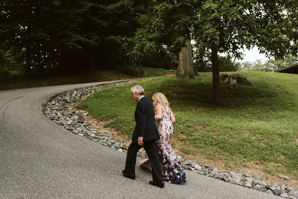 dad walking bride up long path at lake roland for camp wedding