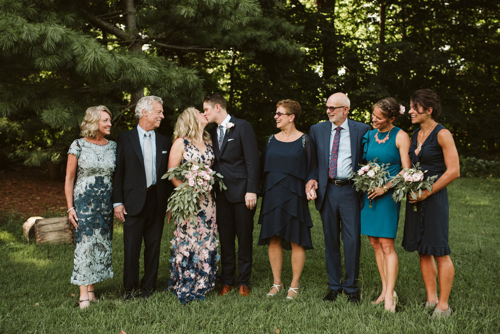 large family portrait at wedding
