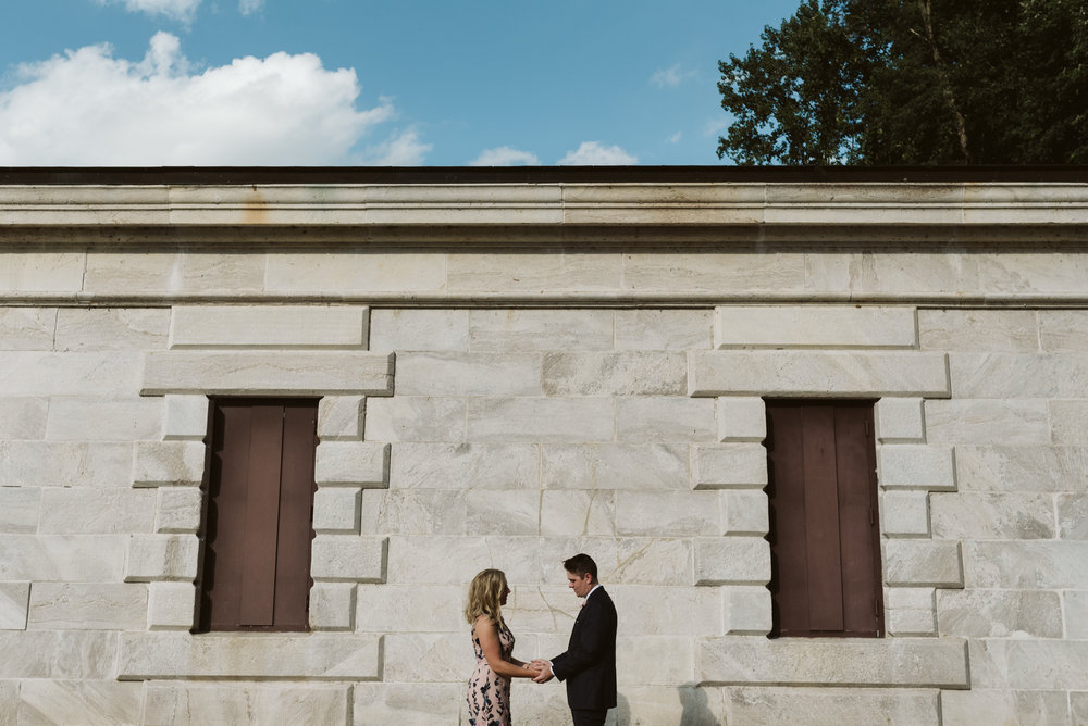 portrait of couple at greek revival style pump house at lake roland on wedding day