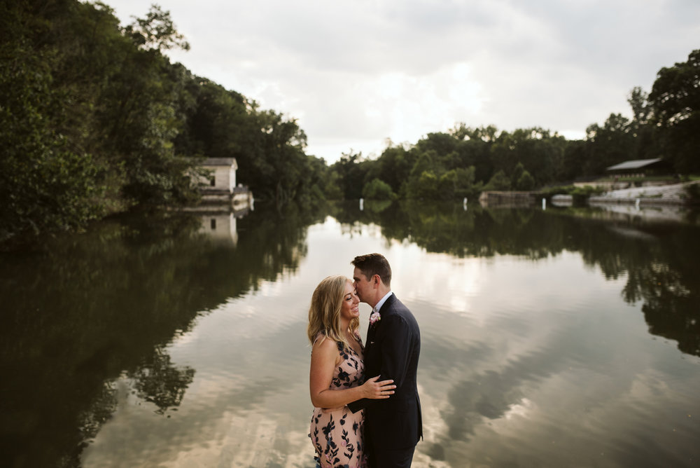 dramatic waterfront portrait at wedding with reflection of trees in lake roland