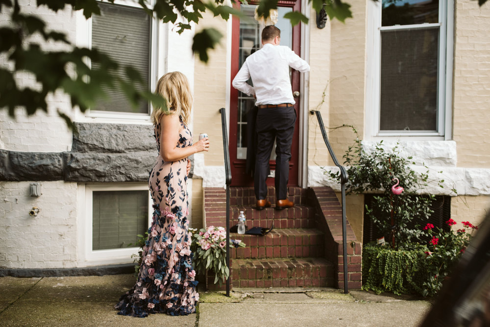 bride and groom going home to hampden rowhouse on wedding day
