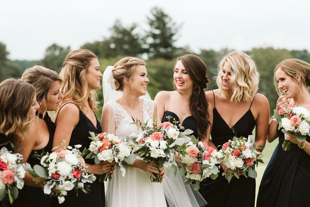 elegant and fun bridal party wearing all black dresses