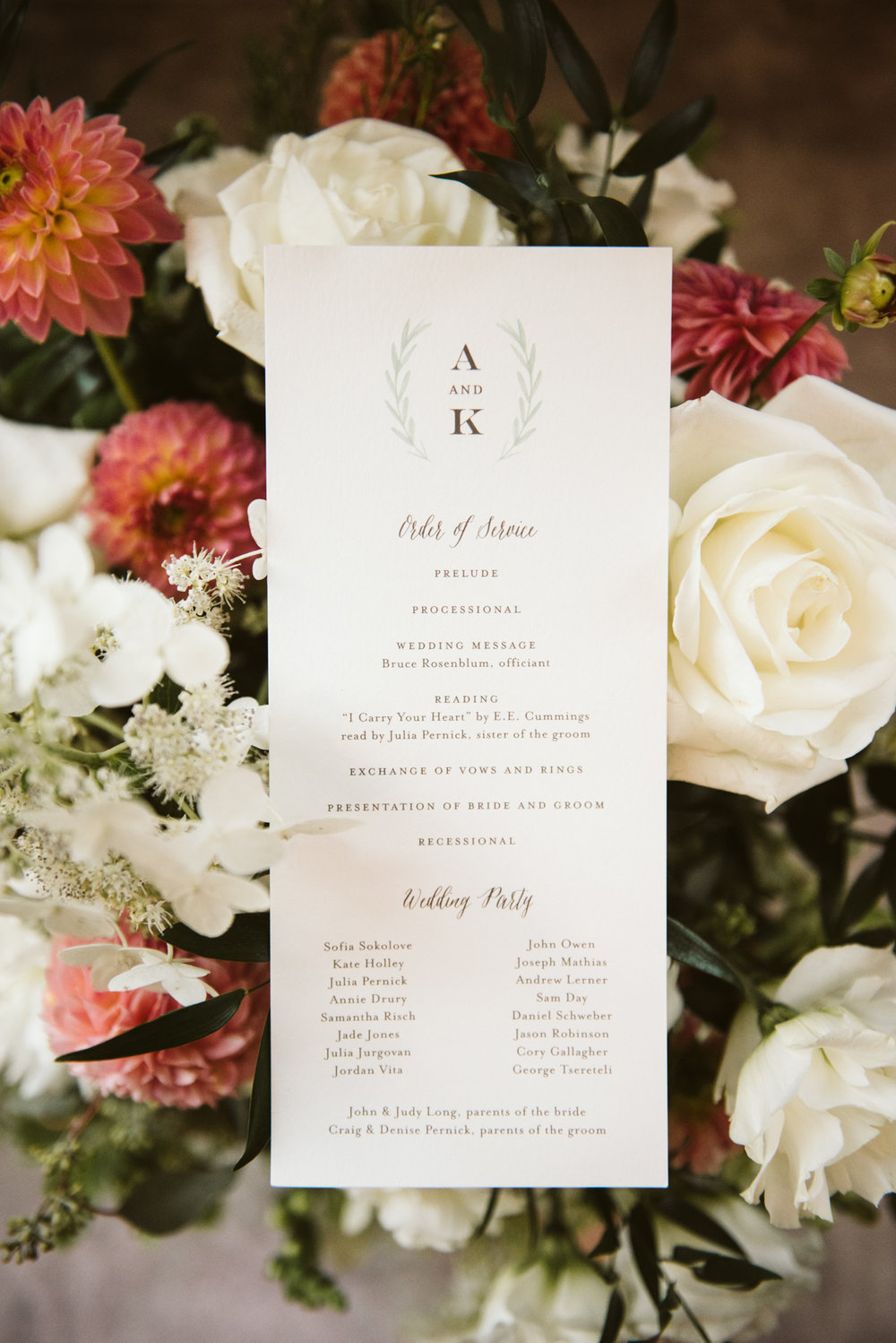 classic and timeless wedding programs sitting in flower arrangement