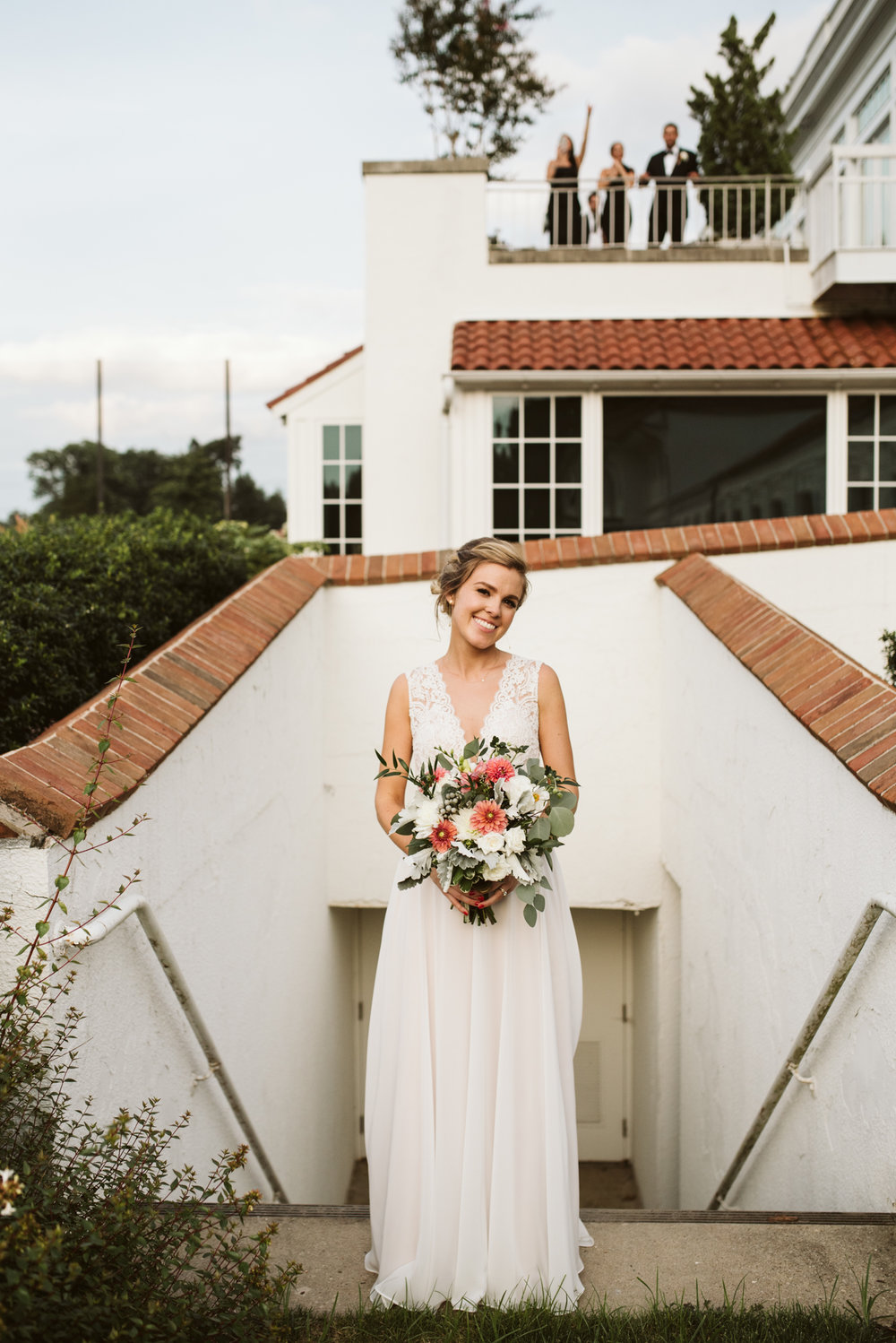 bride looking sweet and beautiful in cool architectural structure with brick and stucco