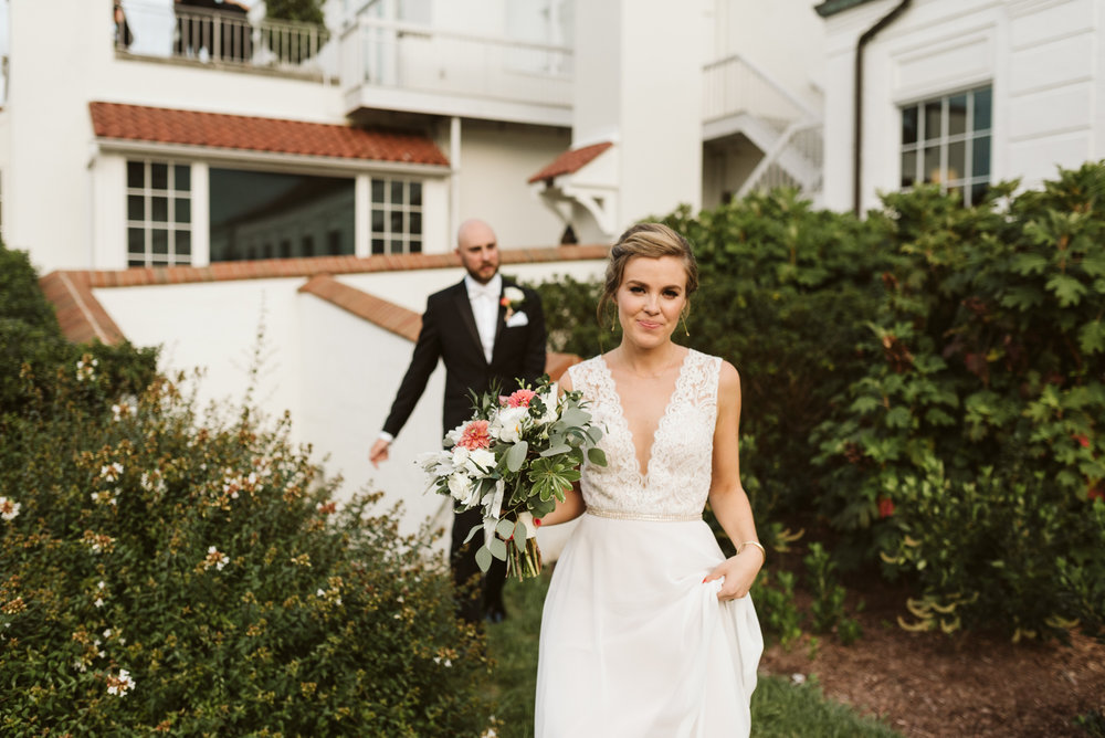 Elegant, Columbia Country Club, Chevy Chase Maryland, Baltimore Wedding Photographer, Classic, Traditional, Bride Walking with Groom in Background, BHLDN Wedding Dress