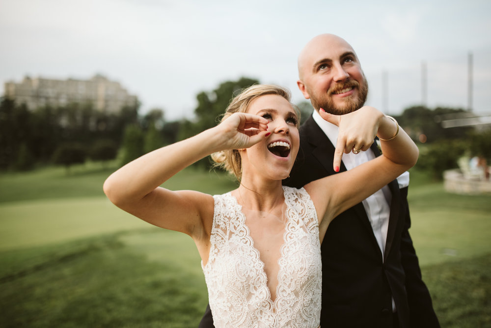 bride and groom having fun at columbia country club wedding