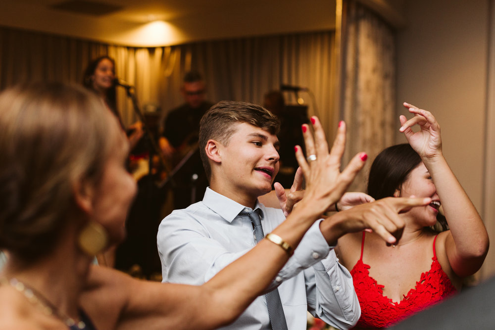 dancing and waving hands at wedding