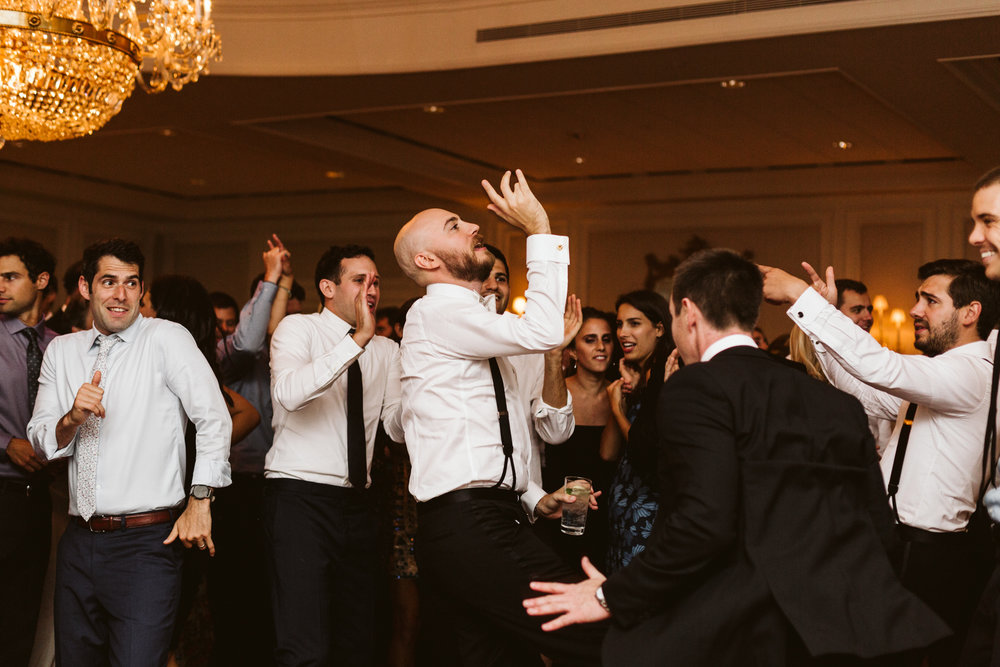 groomsmen dancing to the bachelor boys band