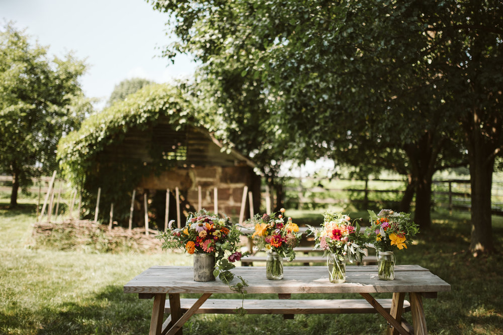 Rocklands Farm, Maryland, Intimate Wedding, Baltimore Wedding Photographer, Sungold Flower Co, Rustic, Romantic, Barn Wedding,  Flower Arrangements in Mason Jars on Picnic Table