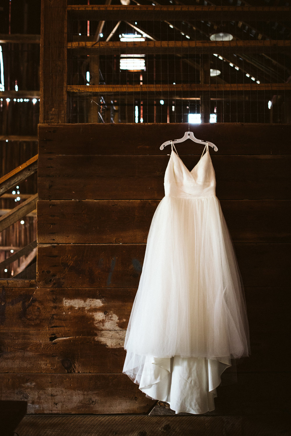 Rocklands Farm, Maryland, Intimate Wedding, Baltimore Wedding Photographer, Sungold Flower Co, Rustic, Romantic, Barn Wedding, Tulle Wedding Dressing Hanging in Barn