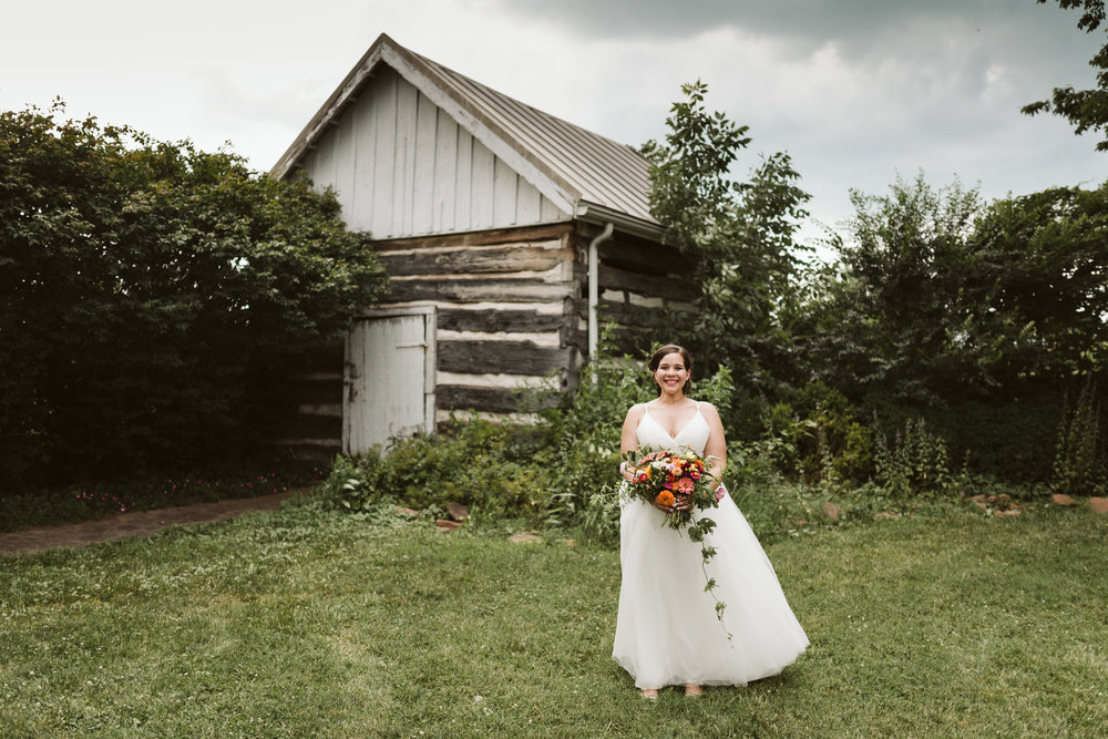 Rocklands Farm, Maryland, Intimate Wedding, Baltimore Wedding Photographer, Sungold Flower Co, Rustic, Romantic, Barn Wedding, Bride Standing Near Barn with Beautiful Bouquet