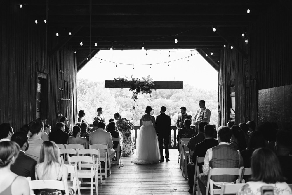 Rocklands Farm, Maryland, Intimate Wedding, Baltimore Wedding Photographer, Sungold Flower Co, Rustic, Romantic, Barn Wedding, Bride and Groom Standing at Altar, Holding Hands, Black and White Photo