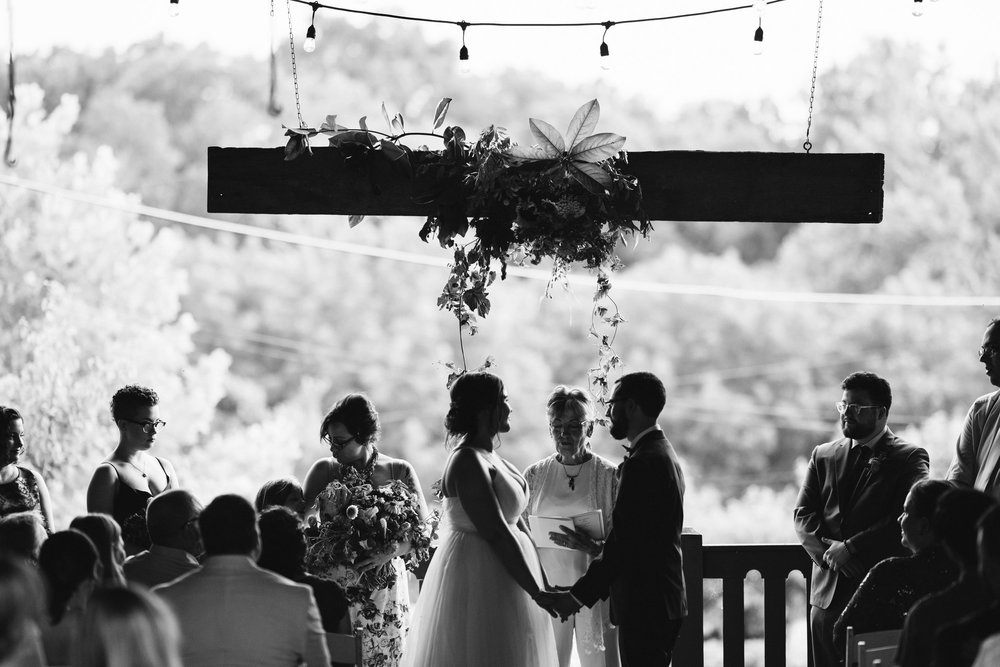 Rocklands Farm, Maryland, Intimate Wedding, Baltimore Wedding Photographer, Rustic, Romantic, Barn Wedding, Bride and Groom Holding Hands in Front of Officiant, Black and White Photo
