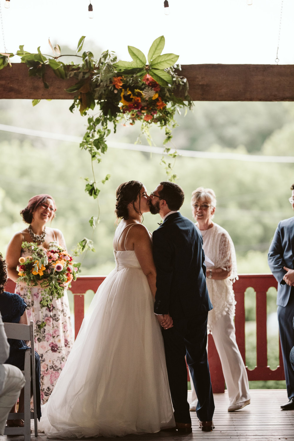 Rocklands Farm, Maryland, Intimate Wedding, Baltimore Wedding Photographer, Sungold Flower Co, Rustic, Romantic, Barn Wedding, Bride and Groom First Kiss Under Flowers
