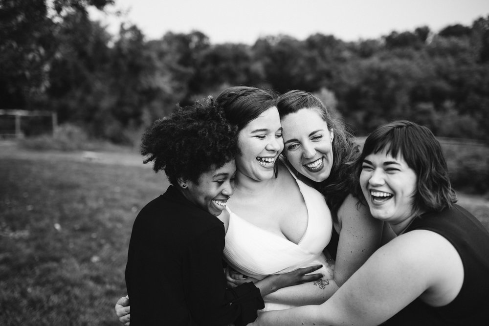 Rocklands Farm, Maryland, Intimate Wedding, Baltimore Wedding Photographer, Sungold Flower Co, Rustic, Romantic, Barn Wedding, Bride Hugging and Laughing with Friends, Black and White Photo