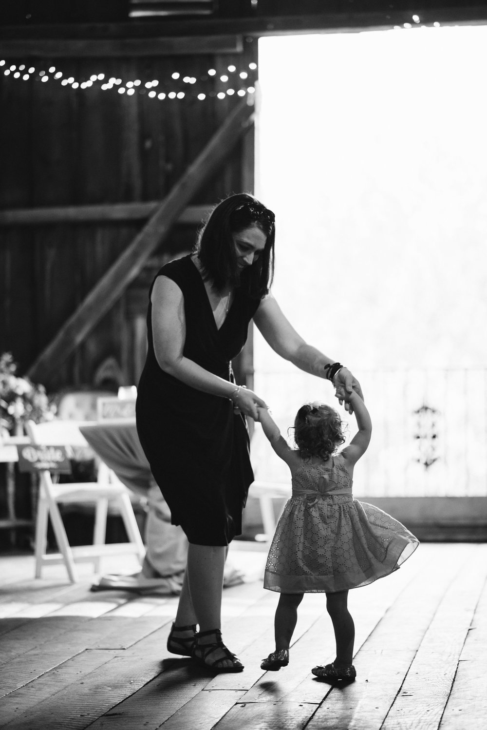 Rocklands Farm, Maryland, Intimate Wedding, Baltimore Wedding Photographer, Sungold Flower Co, Rustic, Romantic, Barn Wedding, Wedding Guest Dancing with Child, Black and White Photo