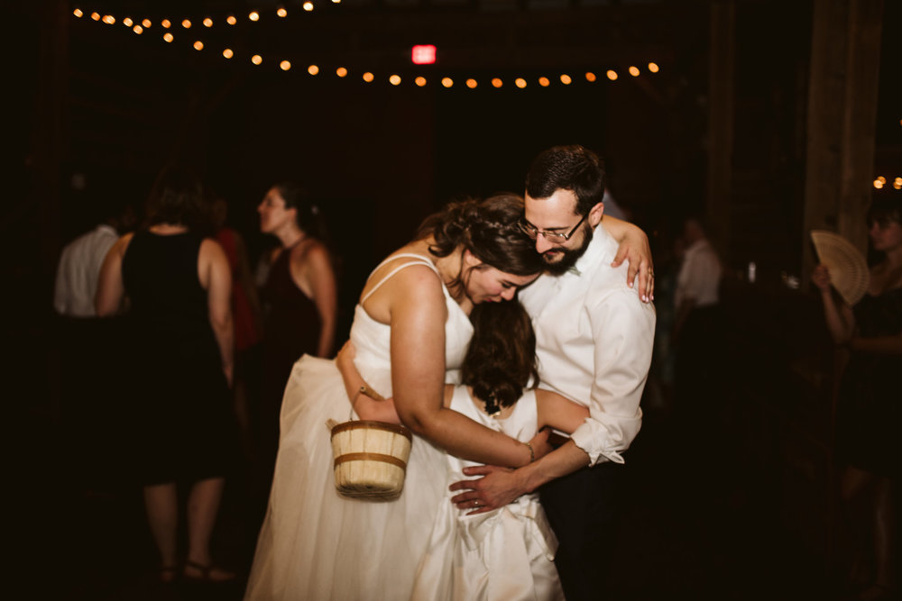Rocklands Farm, Maryland, Intimate Wedding, Baltimore Wedding Photographer, Sungold Flower Co, Rustic, Romantic, Barn Wedding, Bride and Groom Hugging Flower Girl