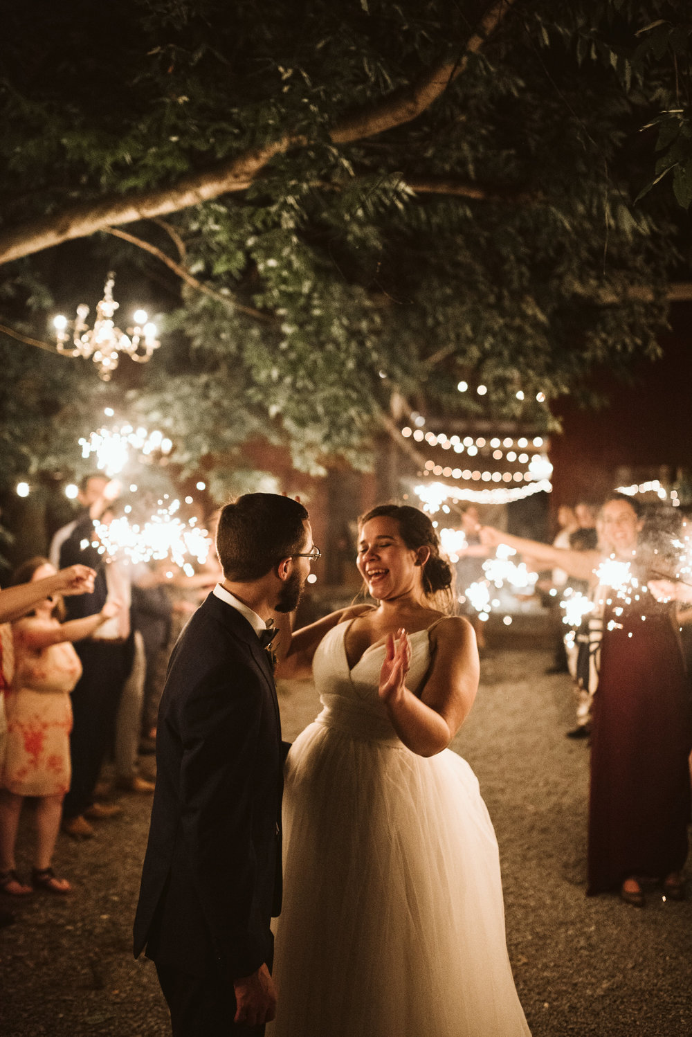 Rocklands Farm, Maryland, Intimate Wedding, Baltimore Wedding Photographer, Sungold Flower Co, Rustic, Romantic, Barn Wedding, Bride and Groom Laughing While Surrounded by Sparklers