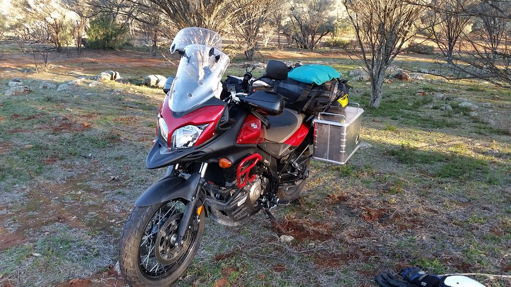 Hard panniers, bash plate, engine protection, windscreen extender and a load on the back. Definitely on tour.