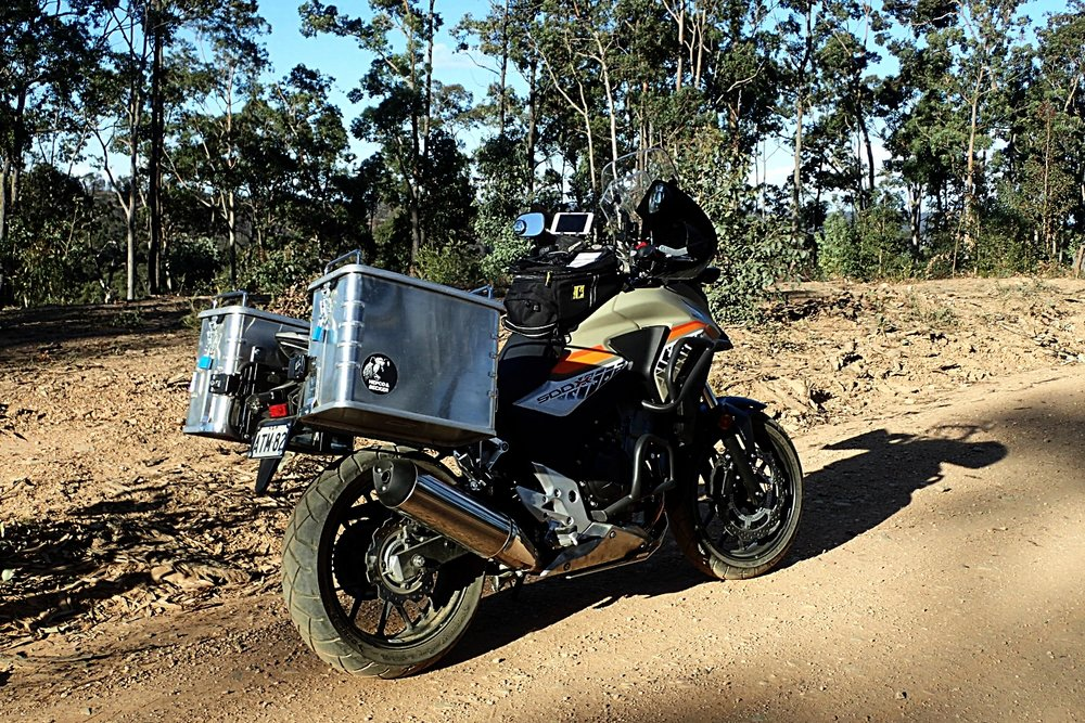 Showing off the panniers, tank bag and engine protection bars (really important to have these). The bash plate needs to be modified to protect the super vulnerable oil filter on the front of the engine. We've also fitted extra large wind guards on the handlebars - well actually I stole Richard's ones!