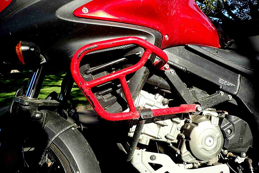 These are stock Suzuki engine bars which are ok. There are plenty of aftermarket ones around. You can see they have been doing their job!