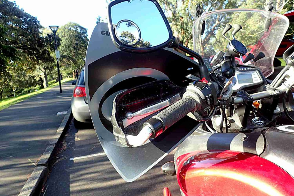 Bark Busters protect the clutch and brake levers in the event of a fall. The heated hand grips are essential to prevent numb hands. Small stick on blind spot mirrors are great. Note the 50mm handlebar risers make a huge difference to my riding posture