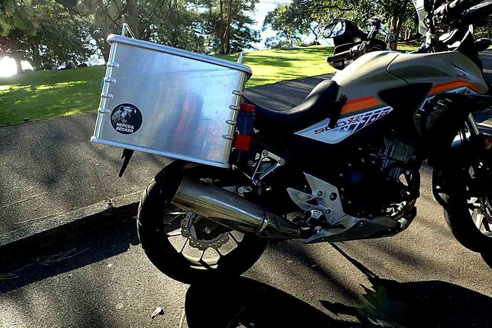 The H&B  panniers sit quite high  as they have to clear the exhaust. This puts the weight high to the back  the bike which isn't ideal for balance and handling.