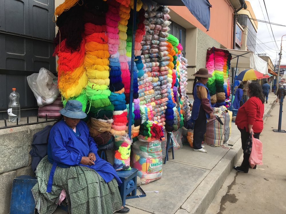 Women selling balls of wool in the busy streets