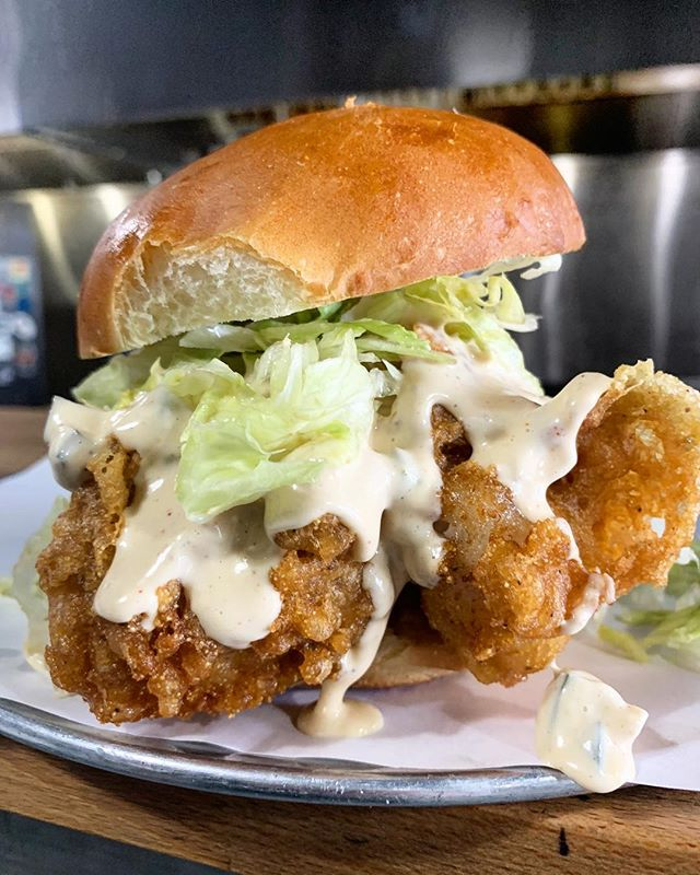 ⚡️ t g i f ⚡️ today's feature is: THE C O D FATHER 😱🤯😱 __________ no meat friday's? no problem. try a #codfather today!  __________ smoked 💨+ beer 🍻battered cod 🐟. tabasco remoulade 🔥. shrettuce 🍃.