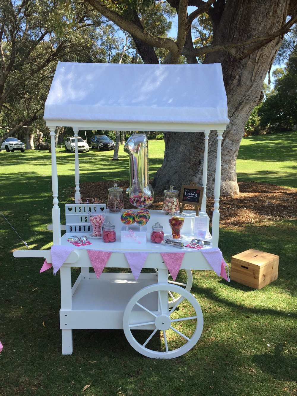 A first birthday Little Lolly Cart set up in Manning Park, Perth