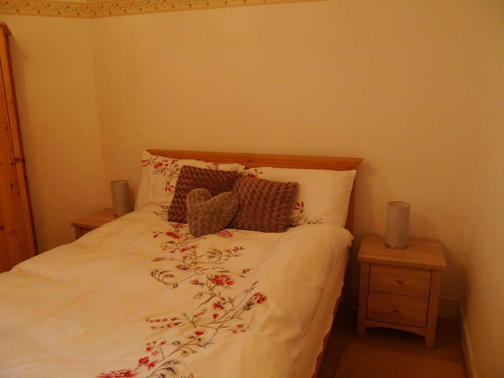 The double bedroom has a double bed, chest of drawers and wardrobe, Bed linen and towels are supplied, there is also a hairdryer