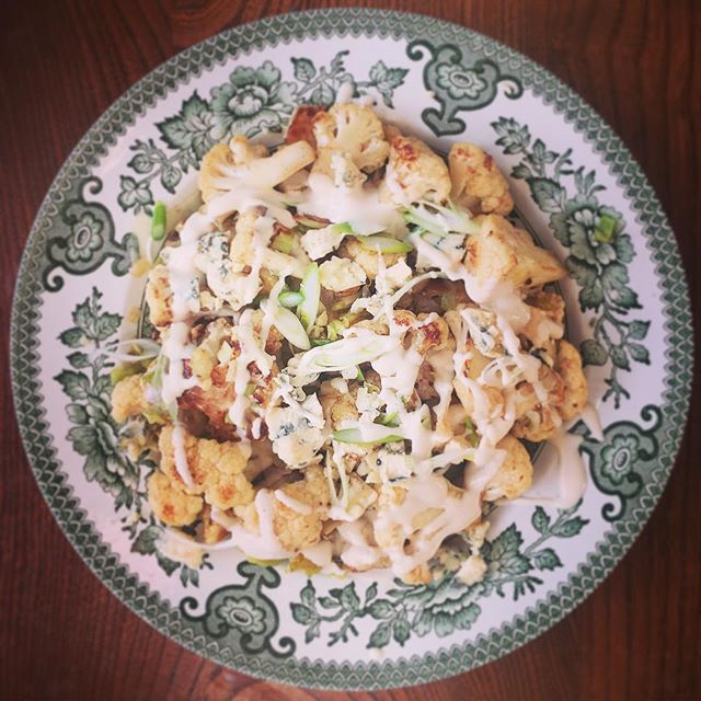 Cauliflower with blue cheese, spring onions and tahini dressing