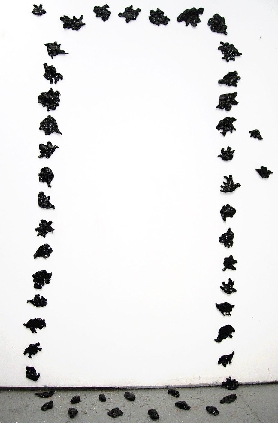 Flock, glazed clay, mounted on wall, dimensions variable