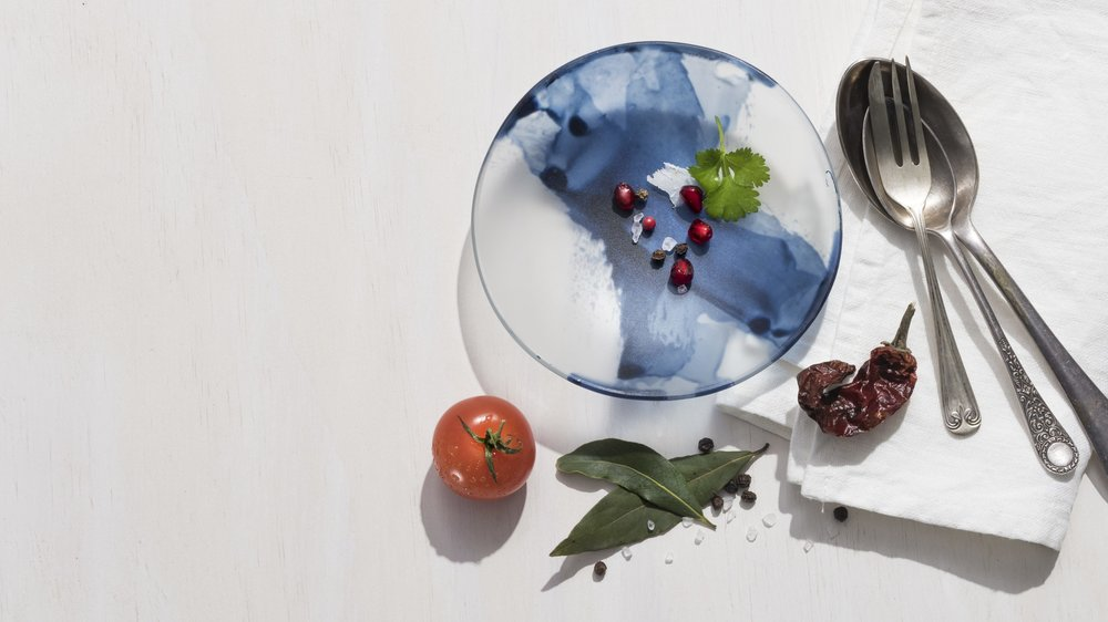 Indigo Swish Bowls, Kiln formed and enamelled glass. Image by Greg Piper
