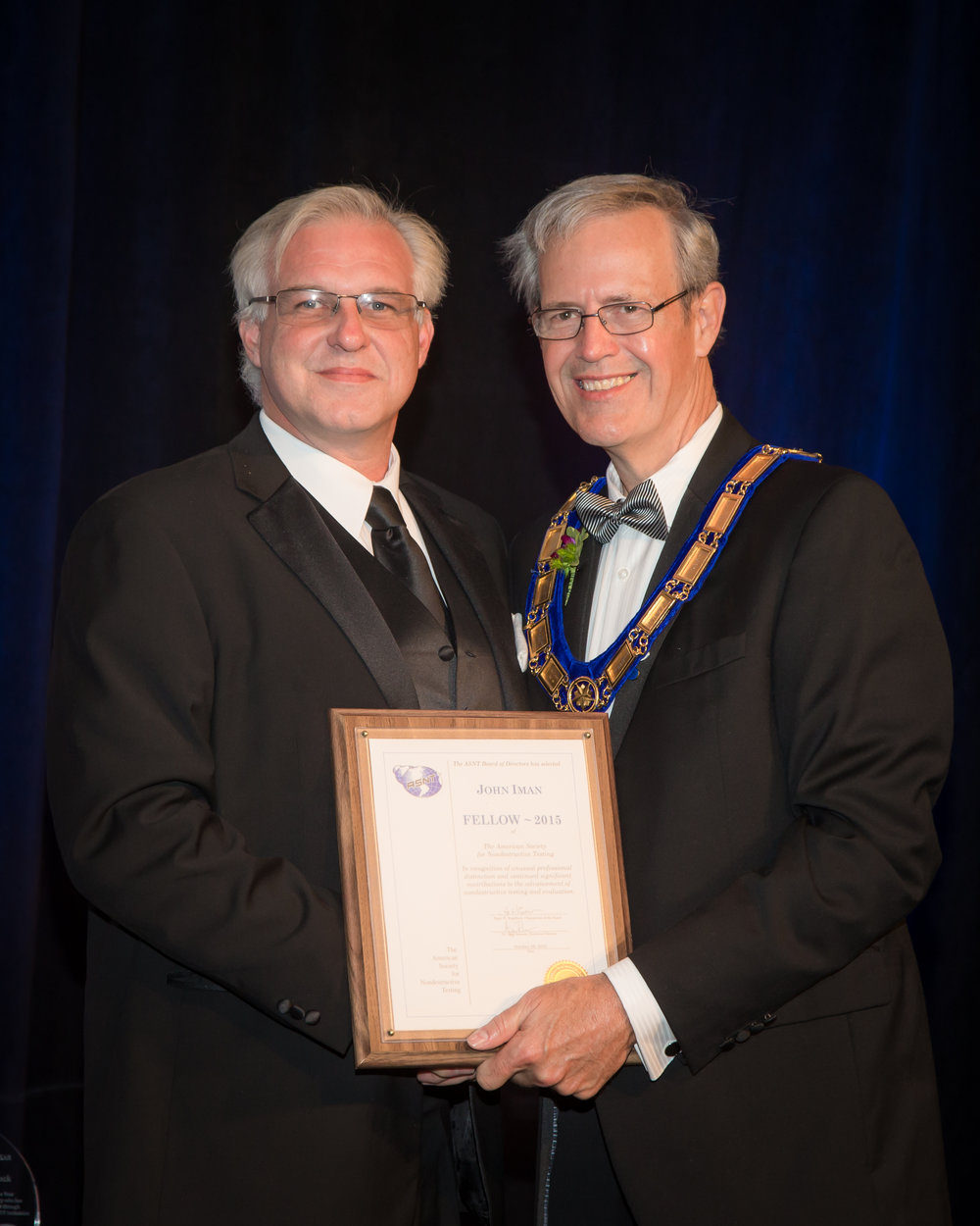 John T. Iman receives ASNT Fellow Award from ASNT past-president L. Terry Claussing.
