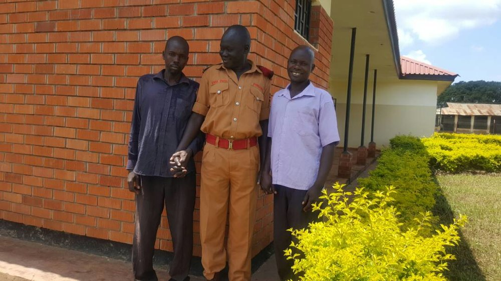 One of our beneficiaries (the one in blue shirt) thanking our PHRA from Kwania after we helped him secure bail2.jpeg