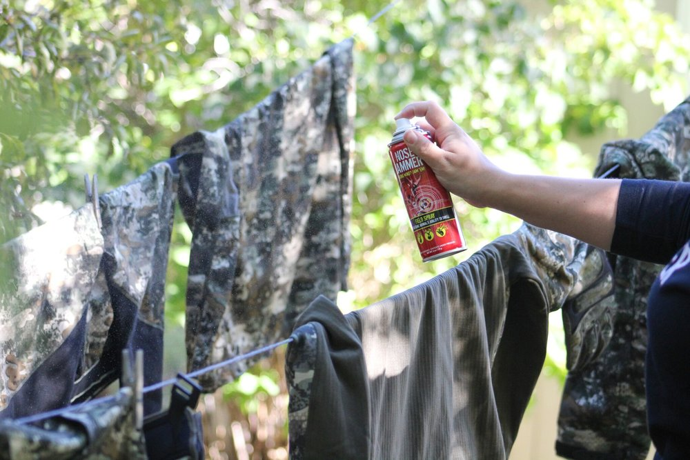 After I pull everything out of the dryer, it's time to for it to hang dry. I like to make sure that everything has had a chance to air out and fully dry. While everything is on the line, I use  Nose Jammer Field Spray  and go through each piece and spray it down. It is just one extra step to make sure things are scent free.