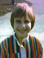 Me, age eight, rocking my groovy rainbow-striped shirt.