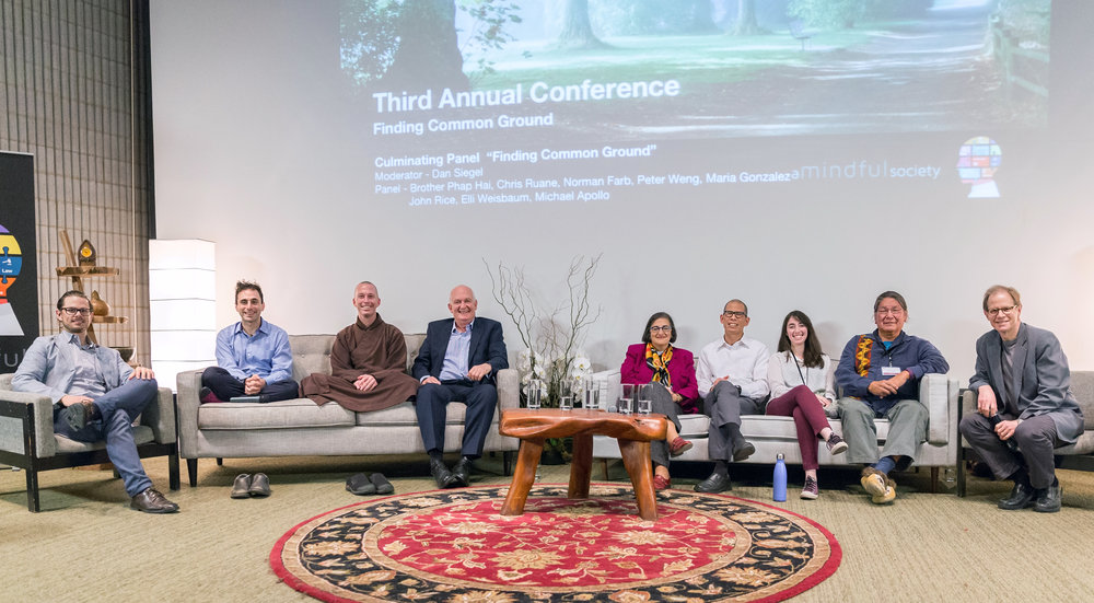 Culminating panel at the 2017 A Mindful Society Conference. From Left: Michael Apollo, Norman Farb, Brother Phap Hai, Chris Ruane, Maria Gonzalez, Peter Weng, Elli Weisbaum, John Rice, Dan Siegel