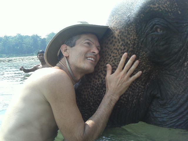 A rare image of Dr. T talking to his elephant in Nepal.