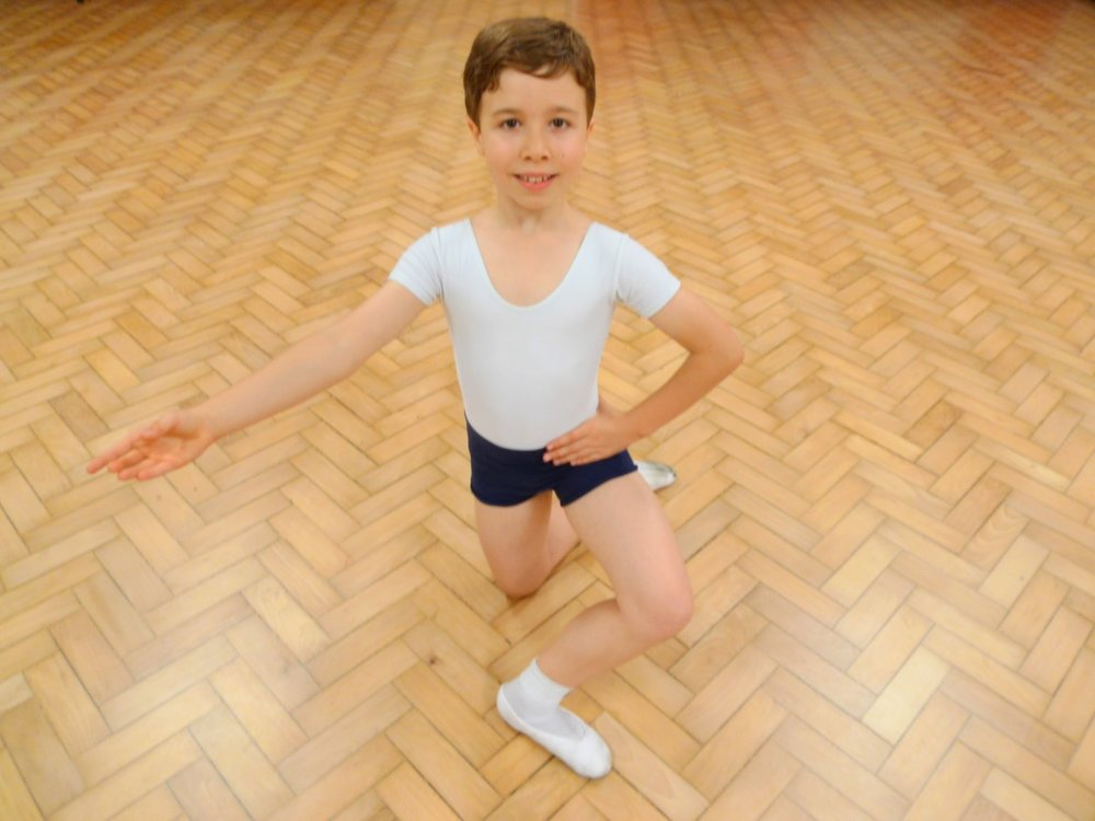 Boy, kneeling, smiling, ballet