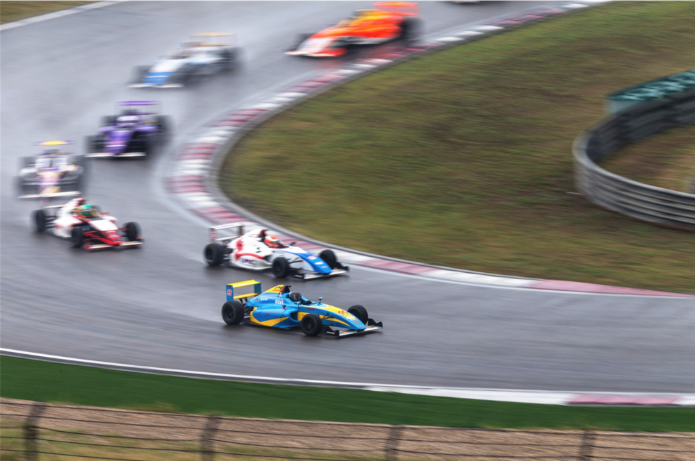 Maxx Ebenal (CAN), Bruno Carneiro (USA) and Yves Volte (GER) lead the field in Shanghai under heavy rain during race 3 of the 2016 FIA F4 Chinese Championship (Sep. 2016) Photo by CFGP