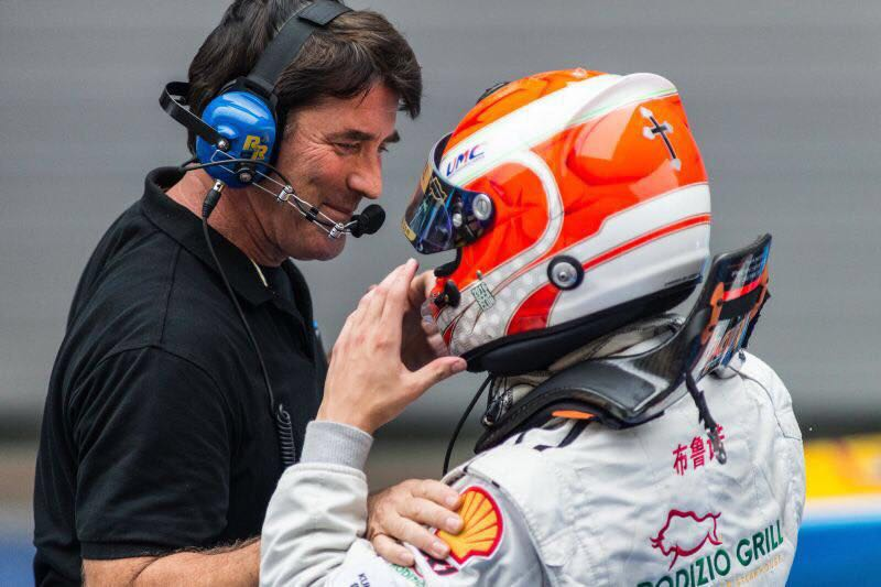 Bruno Carneiro is congratulated by his racing engineer Kent Stacy after winning the F4 race in Shanghai, China (Sep. 2016)