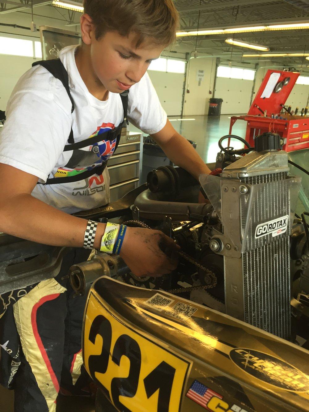 Bruno Carneiro works on his Rotax Junior kart (Sep.2016)