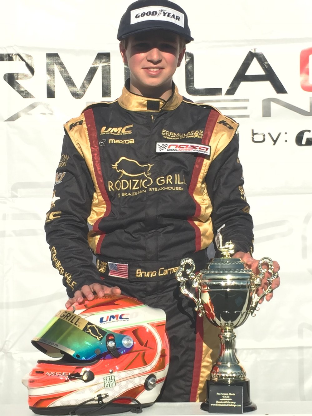 Bruno Carneiro climbs the top of the podium at Thunderhill Raceway. 2016 Formula Car Challenge present by Goodyear