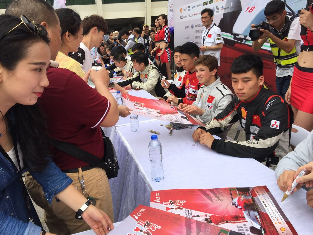 Bruno Carneiro during an autograph session during round 3 of the 2016 FIA F4 Chinese Championship in Beijing, China (Jul. 2016). Photo by Luigi Carneiro