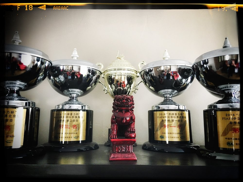 Bruno Carneiro trophies from the 2016 FIA F4 Chinese Championship