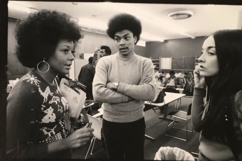 "English teacher George ""Sandy"" Campbell with students, ca. 1971, at Harlem Prep"