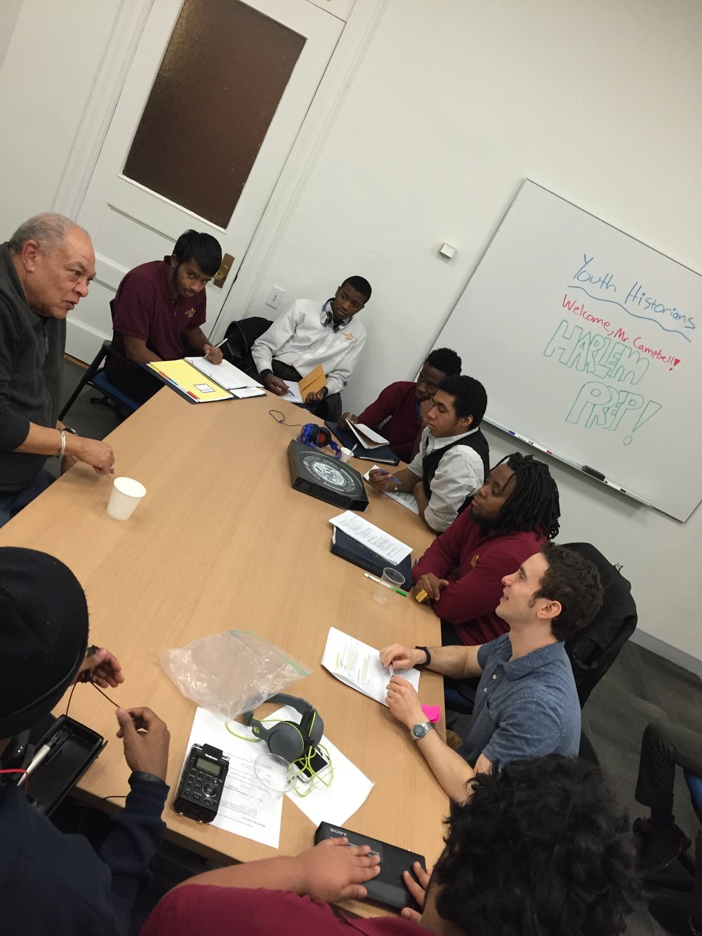 "George ""Sandy"" Campbell being interviewed by Barry Goldenberg and Harlem high school students"