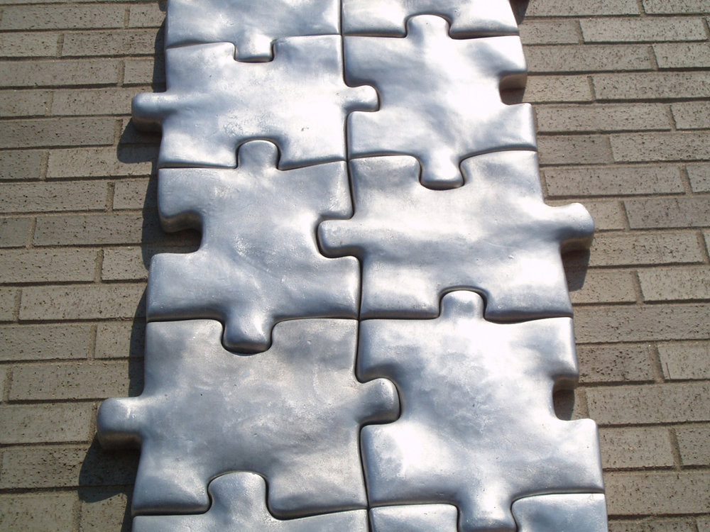 "Puzzled, 1998-1999   Cast Aluminum, 432""h X 24""w X 2""d, detail.   Permanent Collection Plattsburgh Sculpture Park.   Myers Fine Arts Building"